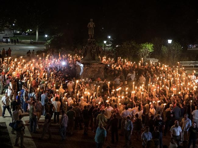 Several hundred white nationalists and white supremacists carrying torches marched in a parade through the University of Virginia campus chanting White lives matter! You will not replace us! and Jews will not replace us! Picture: Evelyn Hockstein/For The Washington Post via Getty Images