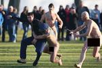 "<p>A ""Streaker"" gets tackled during a Nude rugby players for the traditional game of Nude rugby in Dunedin on June 13, 2009.</p>"