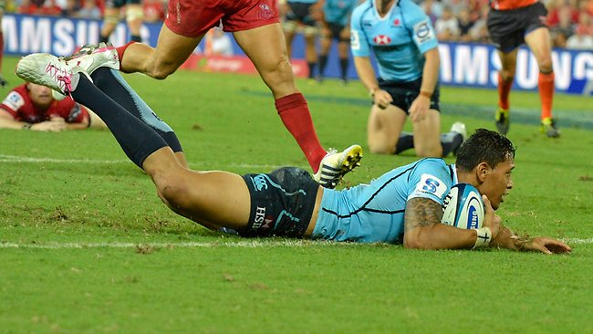 Waratahs fullback Israel Folau dives over to score a try against the Reds at Suncorp Stadium. Picture: Bradley Kanaris