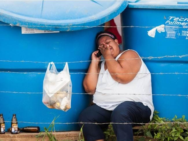A relative cries outside prison in Barquisimeto, Venezuela where inmates die of drug overdoses in the crowded jail. Picture: Dedwison Alvarez.