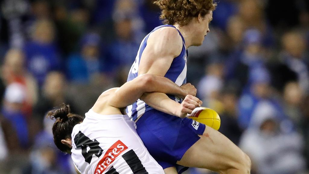 "NEW THEME: AFL umpires at the weekend worked a new ""interpretation"" that punishes tackling that leaves opponents concussed, as was highlighted with North Melbourne forward Ben Brown who was caught holding-the-ball by Collingwood ruckman Brodie Grundy in what Magpies coach Nathan Buckley had defined as the ""perfect tackle"". Picture: Adam Trafford (Getty Images)"