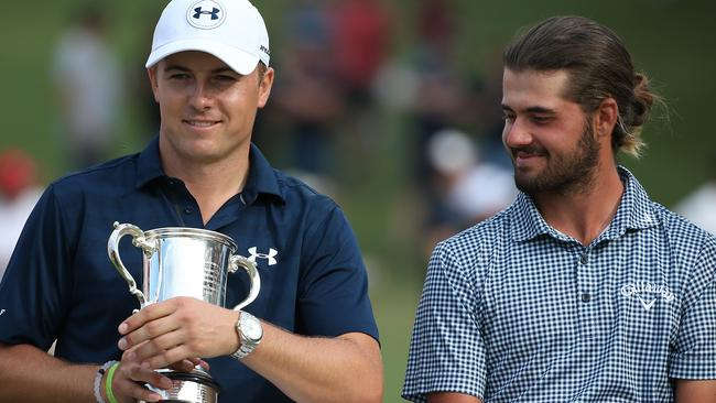 Jordan Spieth from holds the Stonehaven Cup trophy after he won the Australian Open last year. He is sitting next to Australian Curtis Luck.