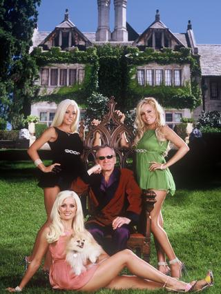Hefner with girlfriends Holly Madison, Kendra Wilkinson and Bridget Marquardt in the TV program Girls of the Playboy Mansion.