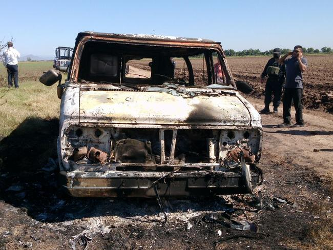 Crucial evidence ... Two charred bodies were found inside this van. DNA tests will be conducted to help identify the remains.