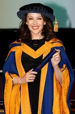 Singer Kylie Minogue holds her honorary degree from Anglia Ruskin University in Chelmsford, England Wednesday Oct. 5, 2011. (AP Photo/Chris Radburn/PA) UNITED KINGDOM OUT NO SALES NO ARCHIVE