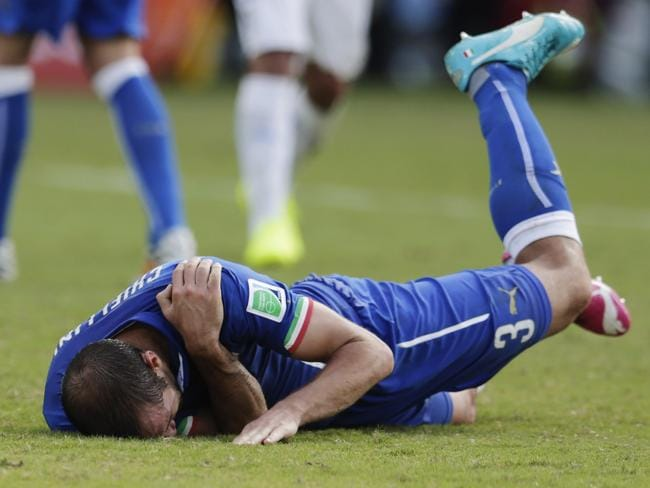 Italy's Giorgio Chiellini holds his shoulder and later accused Uruguay's Luis Suarez of biting him.