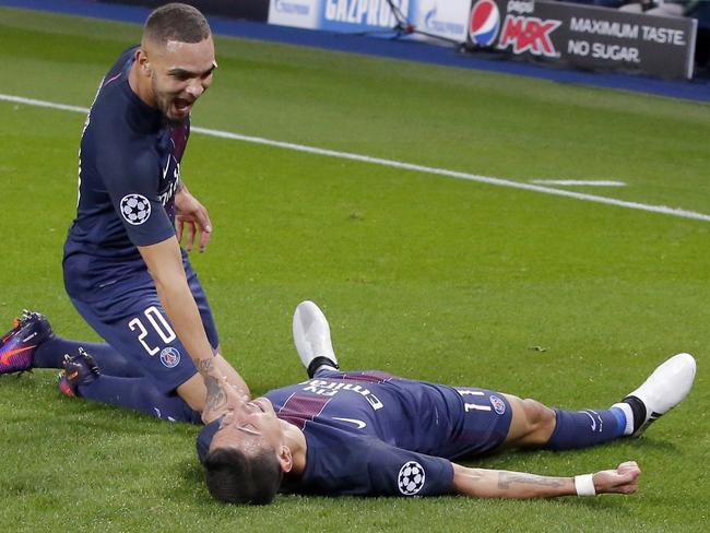 PSG's Angel Di Maria, right, celebrates his opening goal with teammate Layvin Kurzawa.