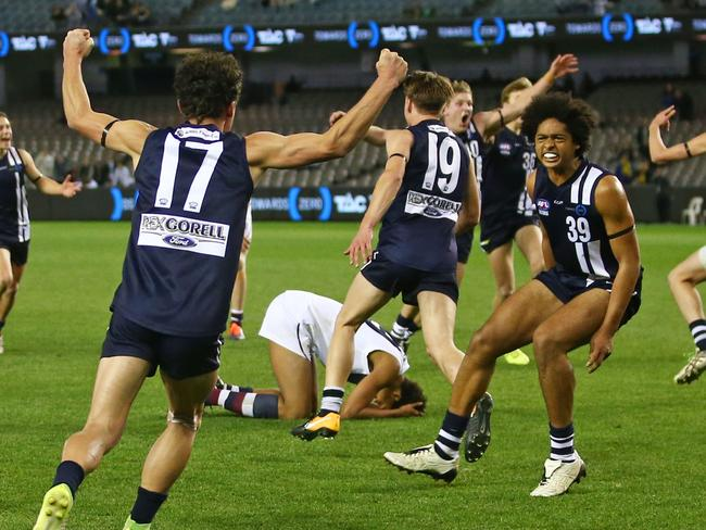 MELBOURNE, VICTORIA - SEPTEMBER 24:  Geelong players celebrate after Joel Amartey of the Sandringham Dragons missed a shot at goal after the siren during the TAC Cup Grand Final match between Geelong and Sandringham at Etihad Stadium on September 24, 2017 in Melbourne, Australia.  (Photo by Scott Barbour/AFL Media/Getty Images)