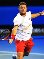 Stanislas Wawrinka lunges for a volley in the first set