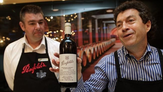 Penfolds winemakers Ben Mehrtens and Peter Gago with a bottle of Grange from 1956. Picture: Ella Pellegrini