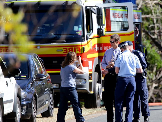 Police talk to residents after chemicals were found in a home in Pullenvale.