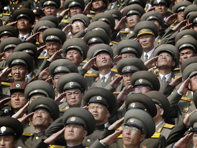 Soldiers salute as their national anthem is played during a military parade to celebrate in North Korea on Saturday. Picture: AP Photo/Wong Maye-E
