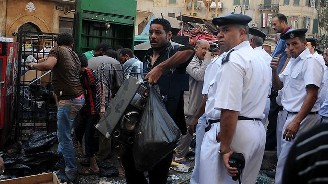 Egyptian street vendors salvage what they can of their belongings after police cleared Tahrir Square in Cairo, Egyp. Picture: Mohammed Asad