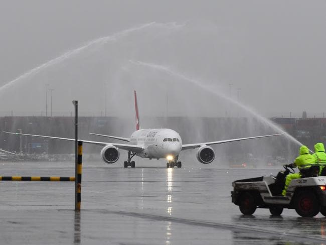 The new Dreamliner was welcomed to Sydney airport with a water cannon salute. Picture: AAP/Dean Lewins
