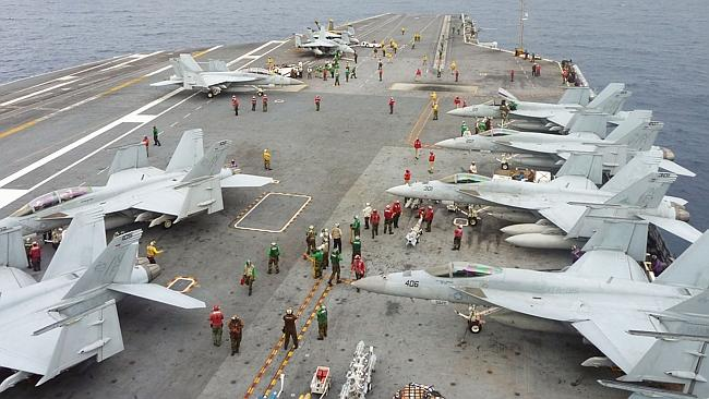 US Navy FA-18 Hornets cram the flight deck of the USS George Washington during a joint military exercise with Japan in the Pa...