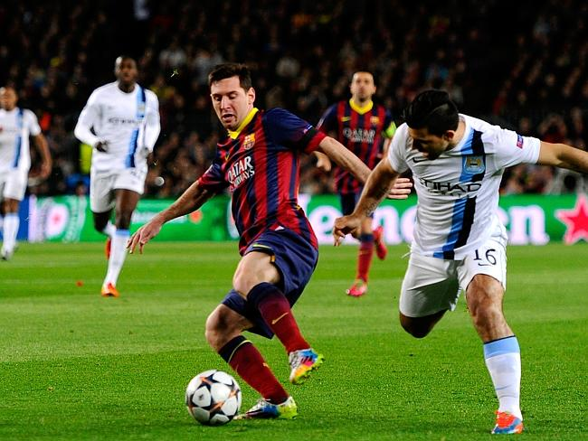 Lionel Messi of Barcelona is challenged by Sergio Aguero of Manchester City. Picture: David Ramos