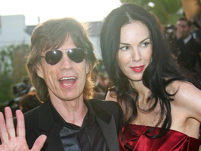 Mick Jagger and his girlfriend L'Wren Scott arrive at the Vanity Fair Oscar Party in March 2006.