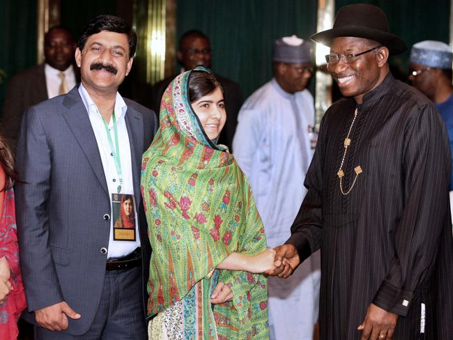 Pakistani education activist Malala Yousafzai shakes hands with Nigerian President Goodluck Jonathan (R) next to her father, Ziauddin Yousafzai ( L). Picture: Wole Emmanuel