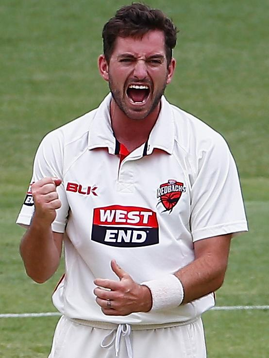 Chadd Sayers celebrates the wicket of Joe Burns.