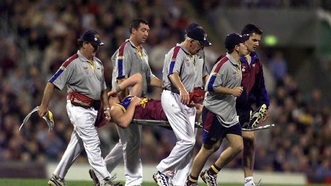 1999 Qualifying Final. Brisbane Lions v Carlton. Gabba. Lions co-captain Michael Voss is carried from the Gabba after suffering a left ankle injury. Picture: Bruce Long