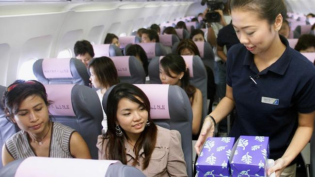 A former airline worker has questioned the hygiene standards on board commercial aeroplanes. Picture: AFP PHOTO/STRAITS TIMES