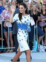 Large crowds cheer and try to catch a glimpse of Catherine, Duchess of Cambridge as she does a walkabout on the South Bank in Brisbane, Australia. The Duchess wore a white L.K. Bennett dress with an artful bright blue poppy print, which sold out instantly. Picture: Getty