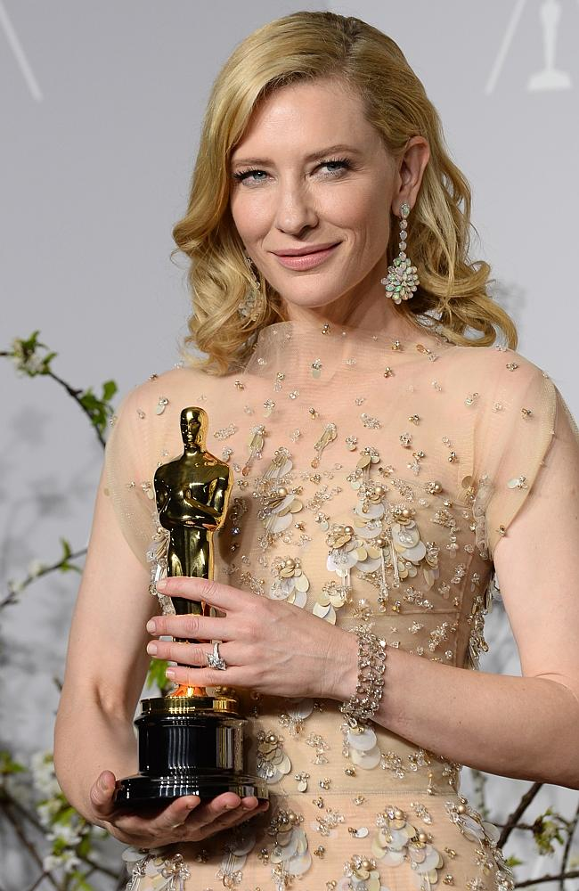 Cate Blanchett poses in the press room with her Best Actress Oscar.