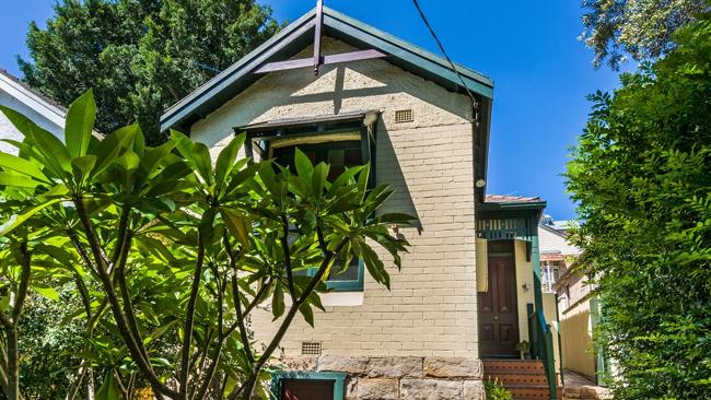 A three-bedroom semi at 71 Bank St, McMahons Point sold for $1.3 million to database buyers. NSW real estate.