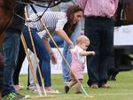 <p>Taking some tentative steps Catherine, Duchess of Cambridge and Prince George of Cambridge practice walking as they attend the Royal Charity Polo. Picture: Getty</p>