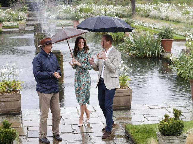 Britain's Prince William, right, and his wife Kate, Duchess of Cambridge are given a tour at the memorial garden in Kensington Palace, London. Picture: AP.