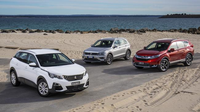 High-riding hatchbacks or 'faux-wheel-drives'? The Peugeot 3008 (left), VW Tiguan (centre) and Honda CR-V (right) are among three of the best. Picture: Supplied.