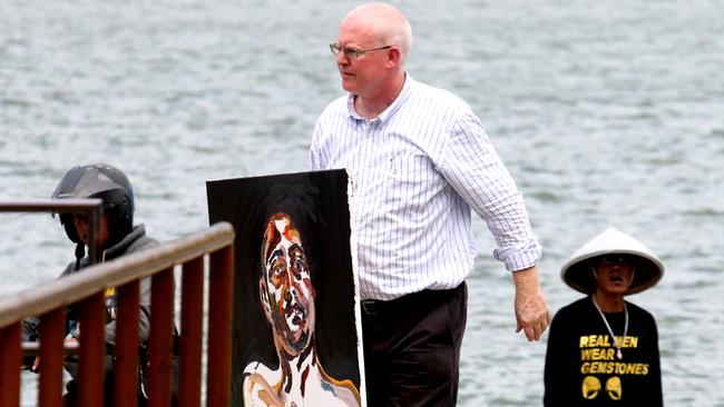 Harrowing works ... Australian lawyer Julian McMahon bring a painting of Myuran Sukumaran's self portrait as back from visit him in Nusakambangan island in Cilacap, Central Java, Indonesia.