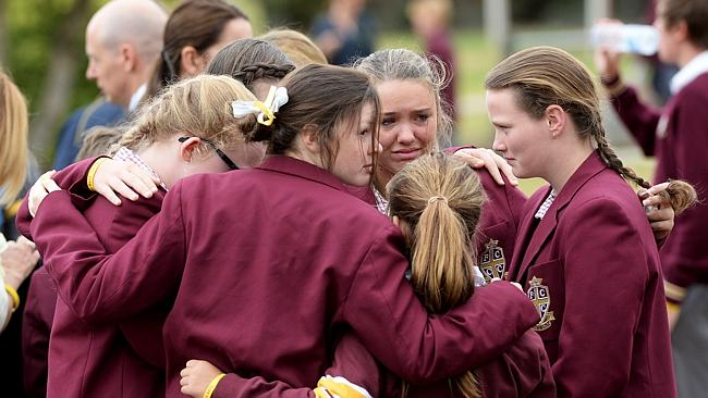 Flinders Christian Community College students comfort each other after the service. Picture: Jake Nowakowski