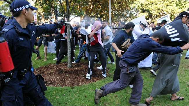 Tear gas used ... Islamic protest in the streets of Sydney. Picture: Simon Bullard