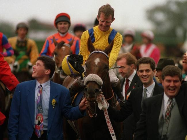 Vintage Crop and legendary jockey Michael Kinane after Vintage Crop won the 1993 Melbourne Cup. Picture: Wayne Ludbey