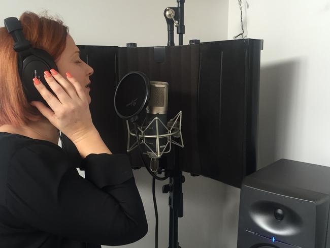 Peta recording her song in studio.