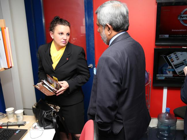 Jacqui Lambie ran into the High Commissioner of Sri Lanka, Admiral Thisara Samarasinghe walking through the press gallery at Parliament House in Canberra. Picture: Gary Ramage