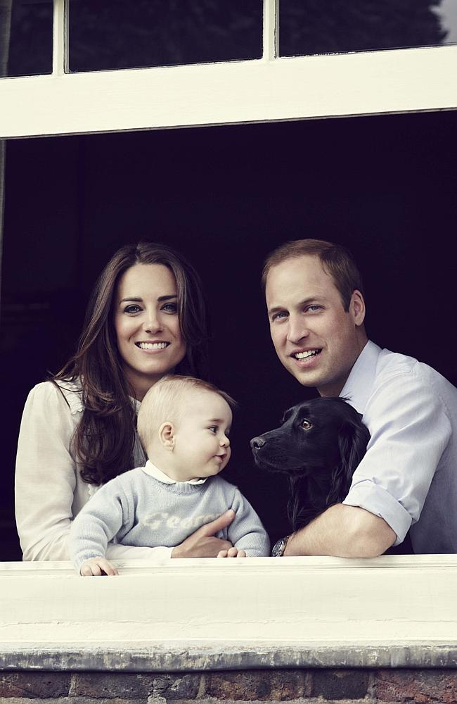 Happy snap ... the Duke and Duchess of Cambridge with their son Prince George photographed at Kensington Palace. Also pictured their dog Lupo. Picture: JASON BELL/CAMERA PRESS.