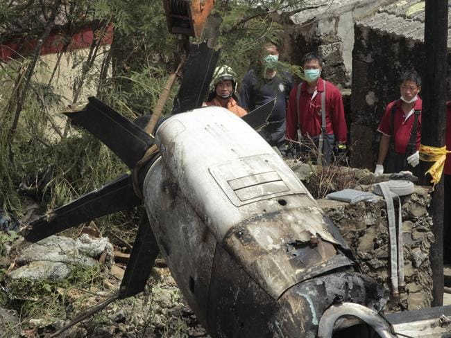 Wreckage ... emergency workers watch an engine lifted from the TransAsia Airways Flight GE222 crash site on the outlying Taiwan island of Penghu.