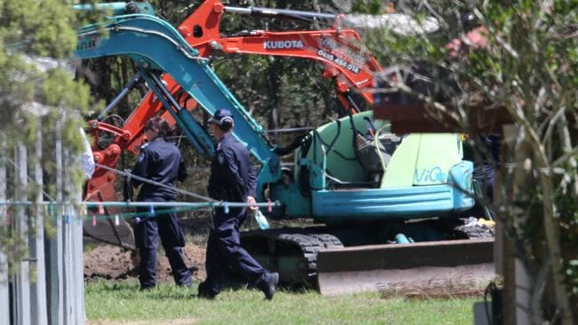 An excavator has been brought in to assist police with their investigation today. Pictures: Jack Tran