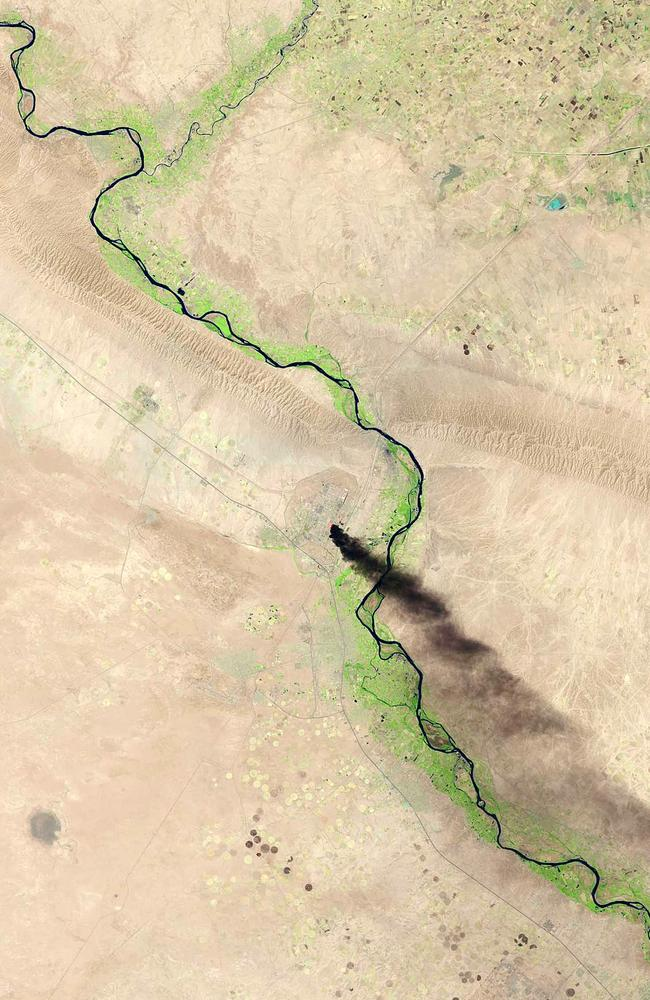 Smoke billows from an Iraqi oil refinery north of Baghdad after an ISIS attack. Picture: USGS/NASA/Getty Images