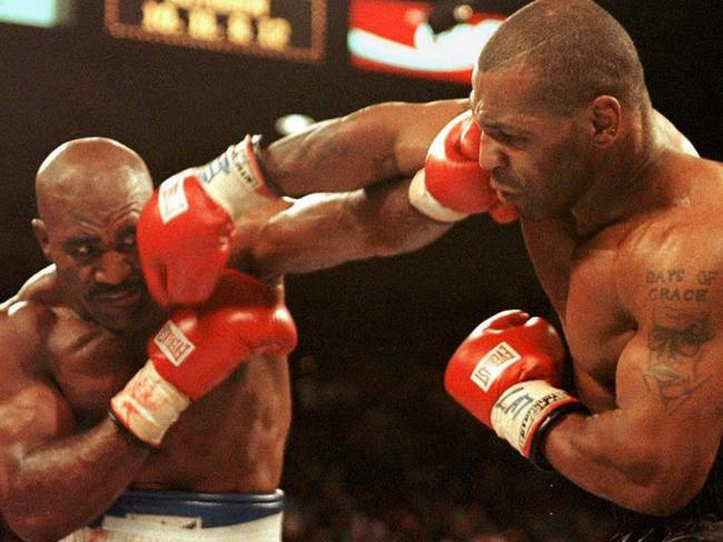 Mike Tyson (right) famously bit Evander Holyfield's ear off.