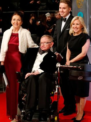 British scientist Stephen Hawking (C) arrives on the red carpet with former wife Jane Hawking (L) and daughter Lucy Hawking (R) for the BAFTA British Academy Film Awards at the Royal Opera House in London on February 8, 2015. Picture: AFP / Justin Tallis.