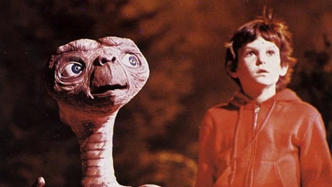 E.T. and actor Henry Thomas in E.T. the Extraterrestrial.