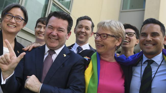 Leader of the Opposition in the Senate Penny Wong, Coalition Senator Dean Smith, Australian Greens Senator Janet Rice, and Sydney state MP Alex Greenwich celebrate the same-sex marriage bill's passing in the Senate. Picture: AAP Image/Lukas Coch