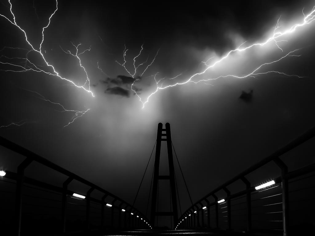 """The Nelson-Mandela-Bridge in Ilmenau (Germany) during a heavy summer thunderstorm. Two intense lightnings illuminate the whole bridge."" Picture: Stefan Liebermann, Germany, Shortlist, Open Low Light, 2016 Sony World Photography Awards"