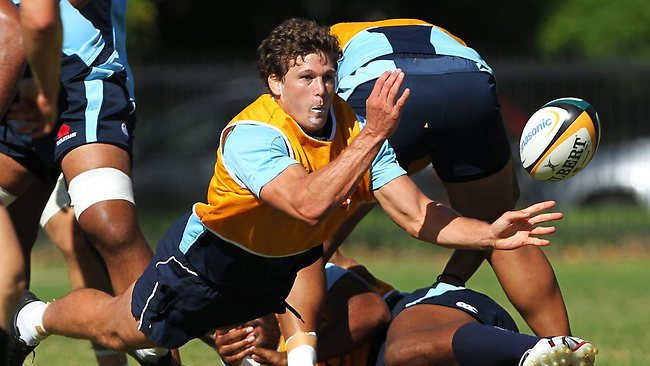 In this file picture, Luke Burgess dishes the ball at at a Waratahs training session. Photograph: Phil Hillyard.