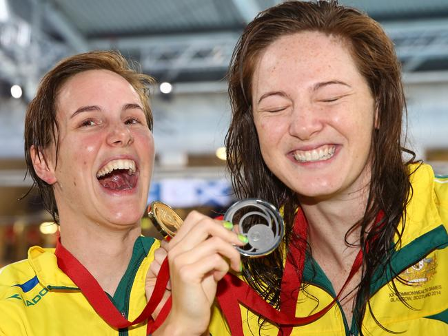 Bronte (left) and Cate (right) Campbell celebrate their dominant performance in the 100m freestyle.