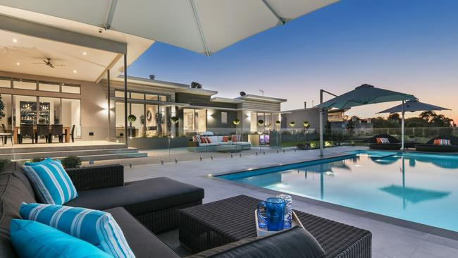 The interiors open easily to an inviting pool and outdoor entertainment area.