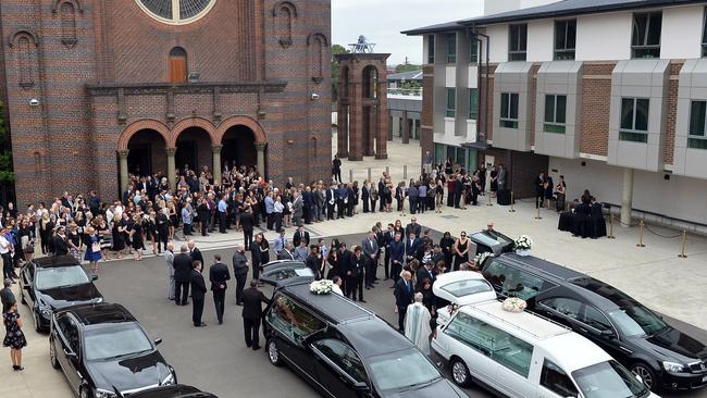 Family and friends gather to farewell Lars, Vivian and Annabelle Falkholt earlier this month. Picture: AAP